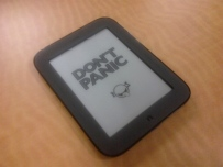 "Nook with ""Don't Panic"" on the screen"